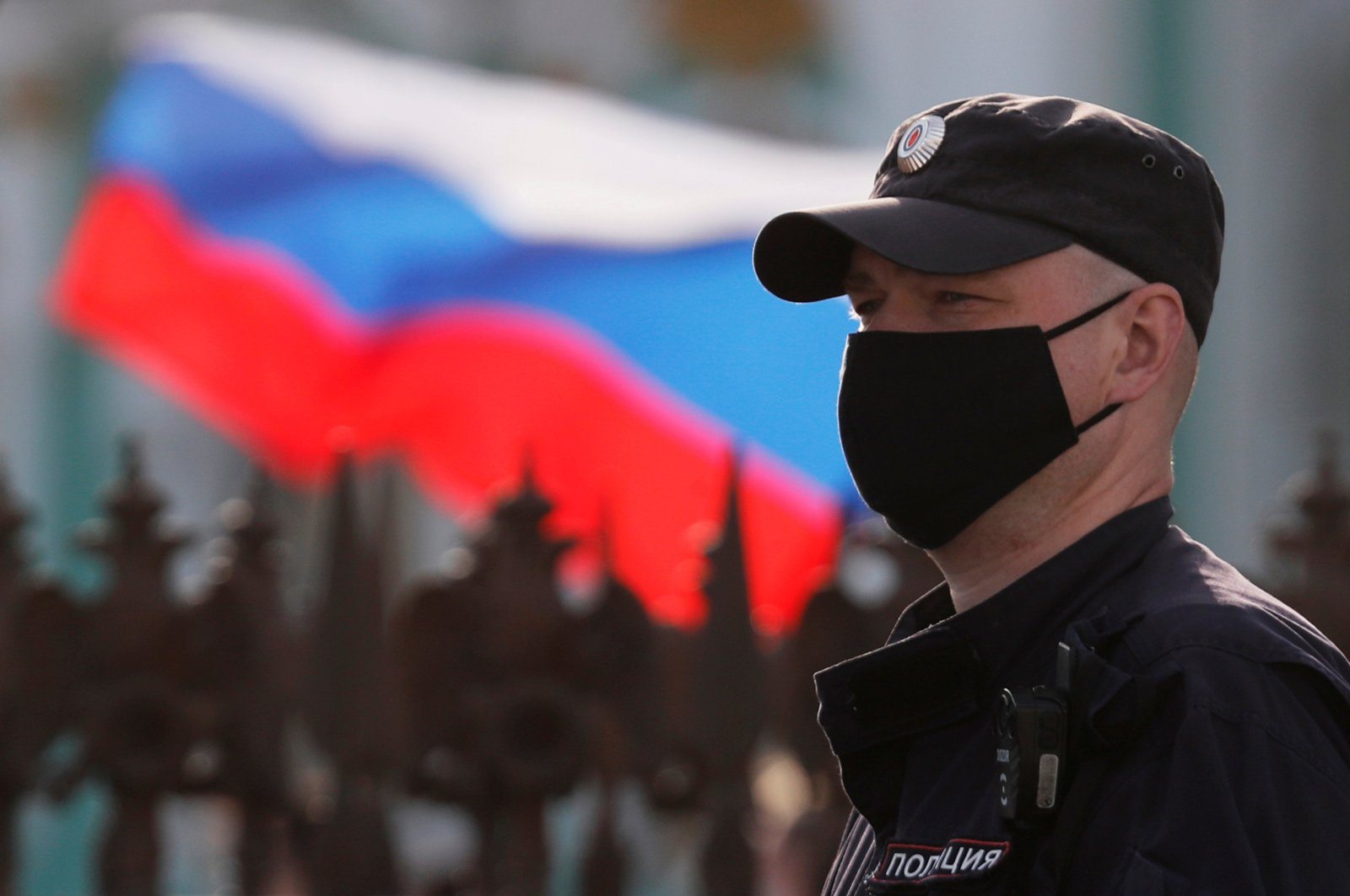 A police officer wearing a protective face mask stands guard at Dvortsovaya Square in Saint Petersburg, Russia June 12, 2020. (Reuters Photo)