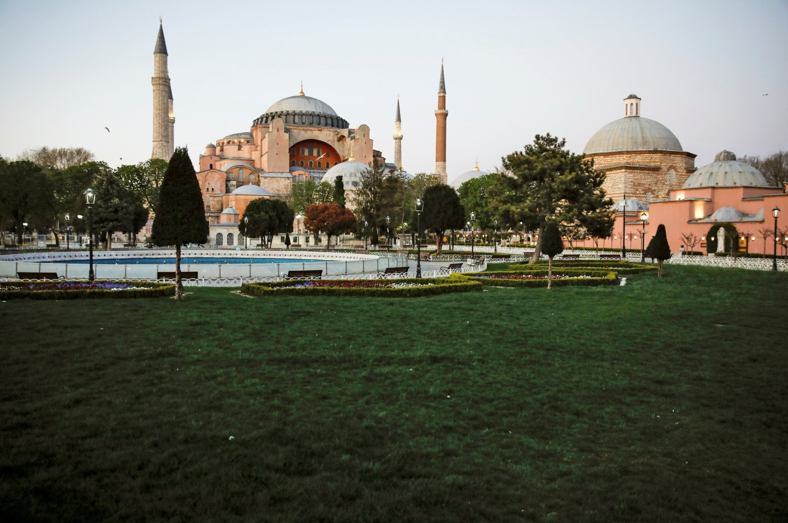 A wide shot of a deserted Sultanahmet Square with the Byzantine-era monument of Hagia Sophia in the background on the first day of the holy month of Ramadan during a four-day curfew imposed to prevent the spread of the coronavirus, Istanbul, Turkey, April 24, 2020. (Reuters Photo)