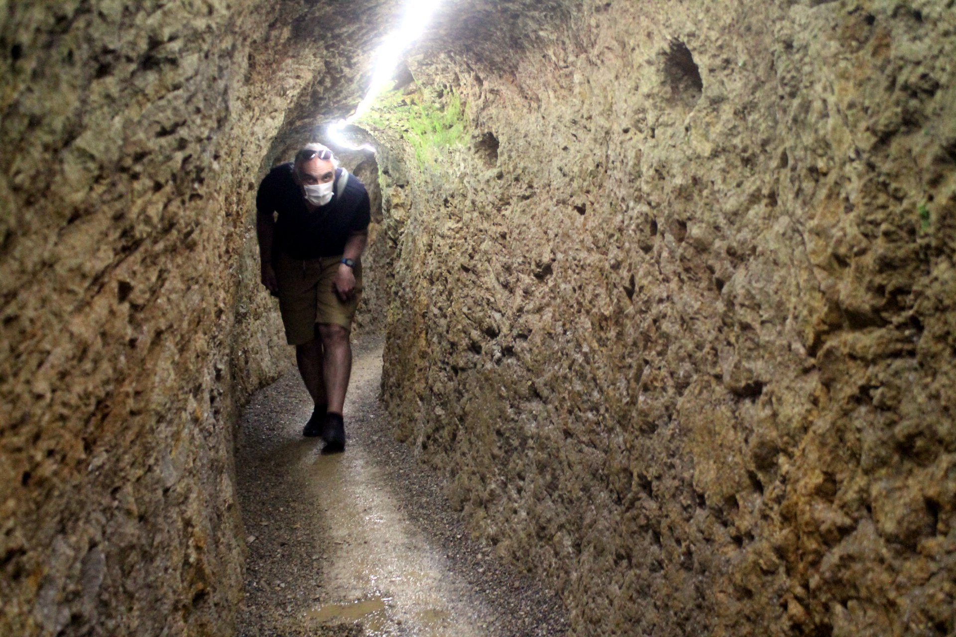 A visitor passes through a corridor of the underground city. (AA PHOTO)