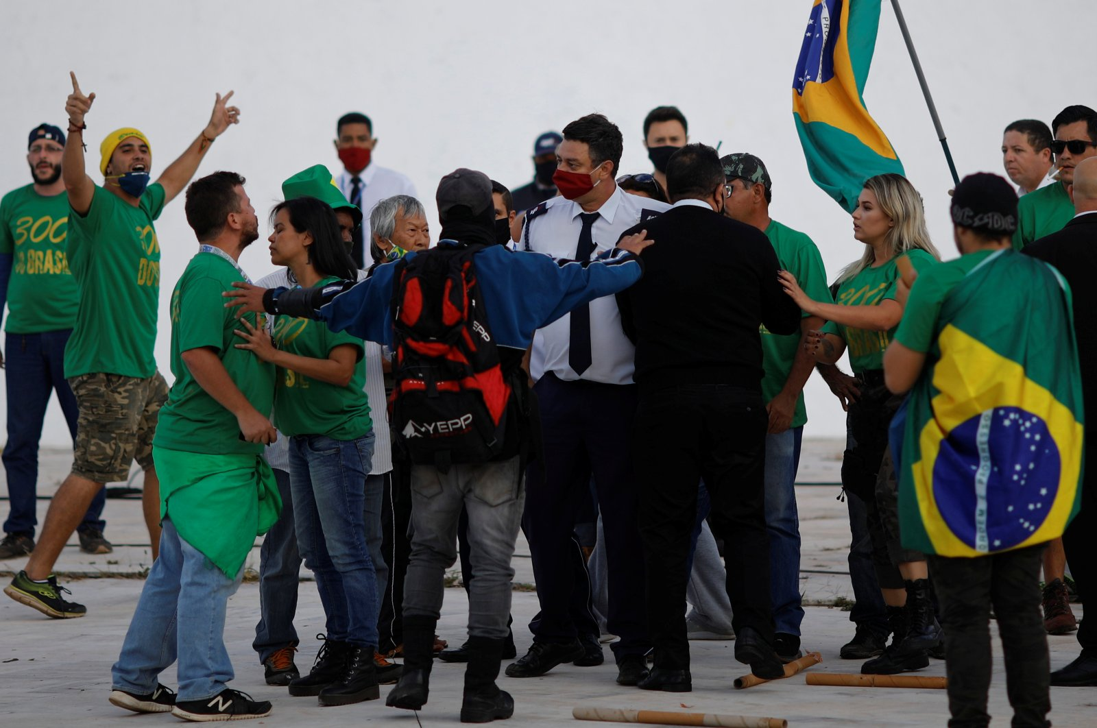 Demonstrators attend a protest against the National Congress and in support of the government of Brazil's President Jair Bolsonaro outside the National Congress building in Brasilia, Brazil June 13, 2020. (Reuters Photo)