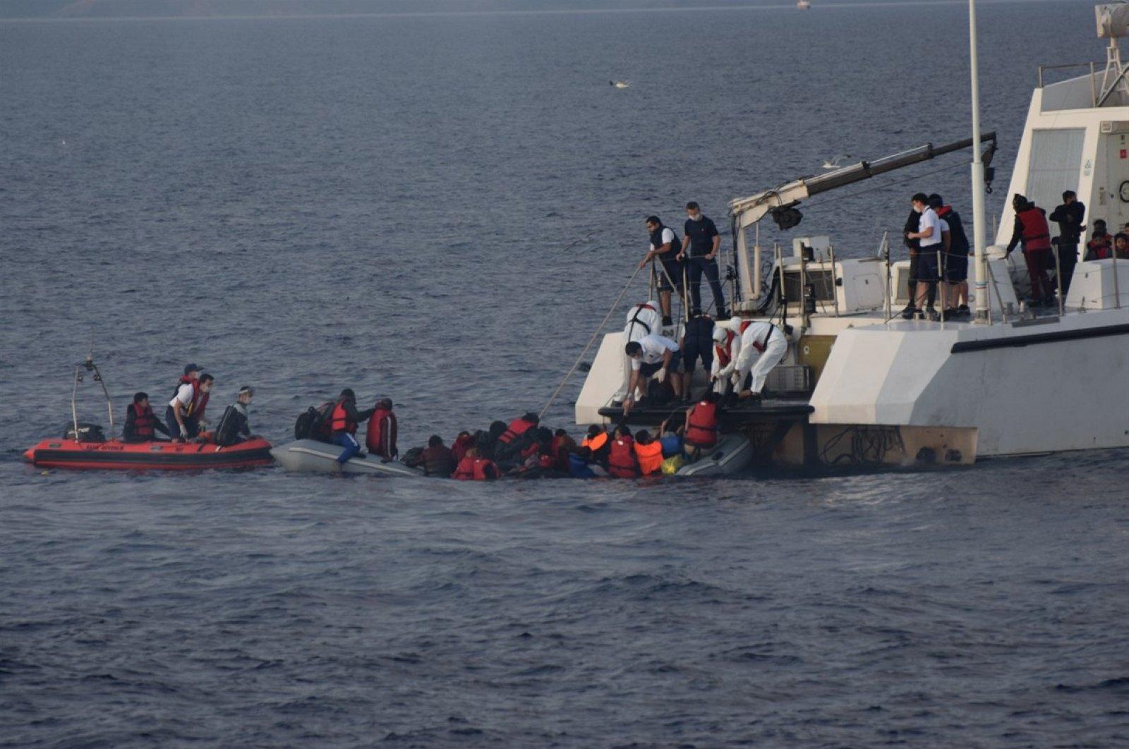Turkish coast guard rescues asylum-seekers pushed back by Greece near western Çanakkale province in the Aegean Sea, June 13, 2020. (DHA)