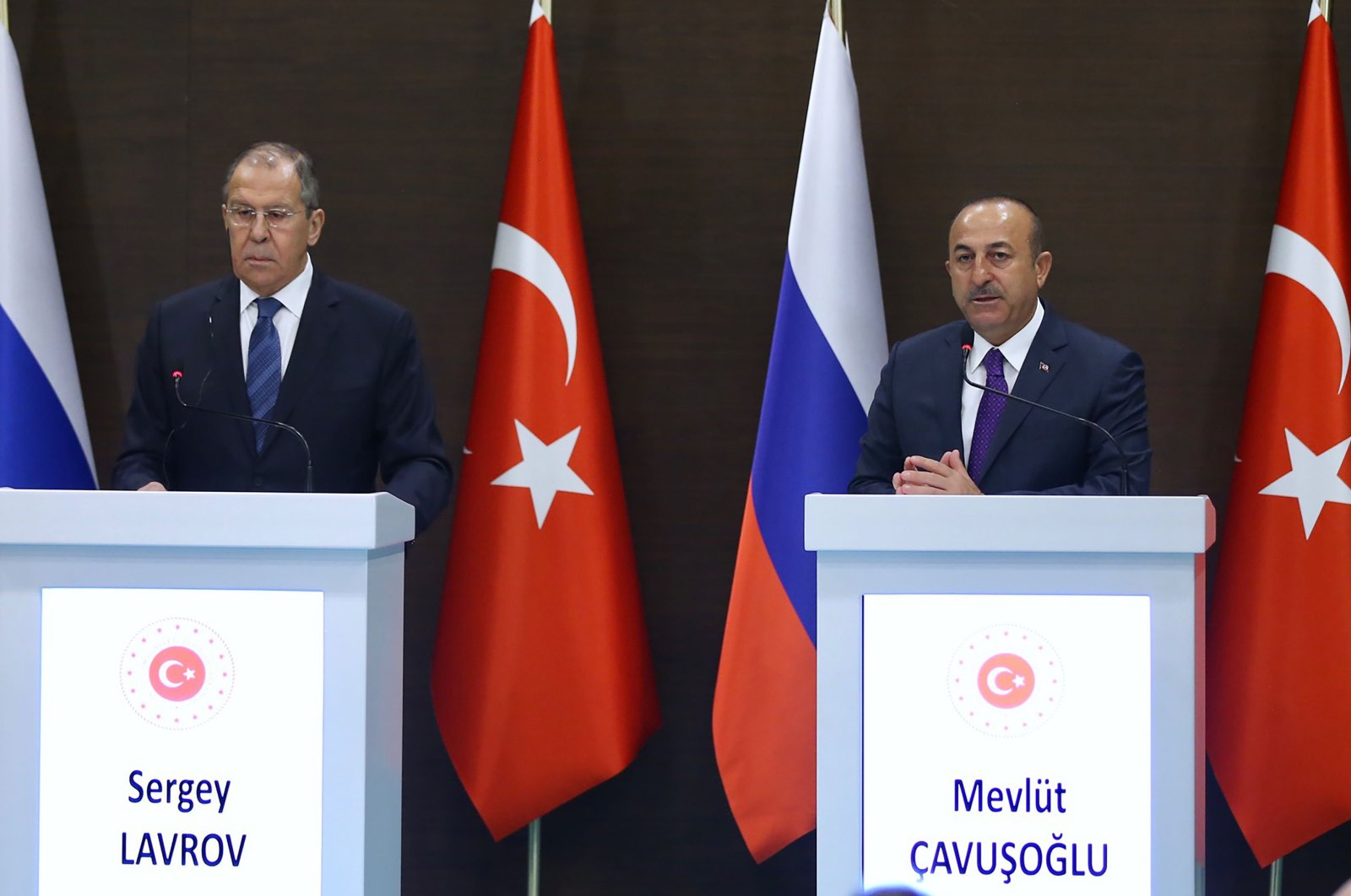 This handout picture taken and released by the Turkish Foreign Ministry in Antalya shows Turkish Foreign Minister Mevlüt Çavuşoğlu (R) and his Russian counterpart Sergei Lavrov (L), March 29, 2019.  (Turkish Foreign Ministry Press Office Photo via AFP)