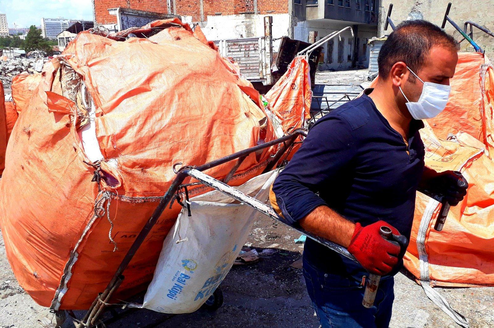 An undated photo shows Yakup Çelik with his waste bag, Ankara, Turkey. (AA Photo)