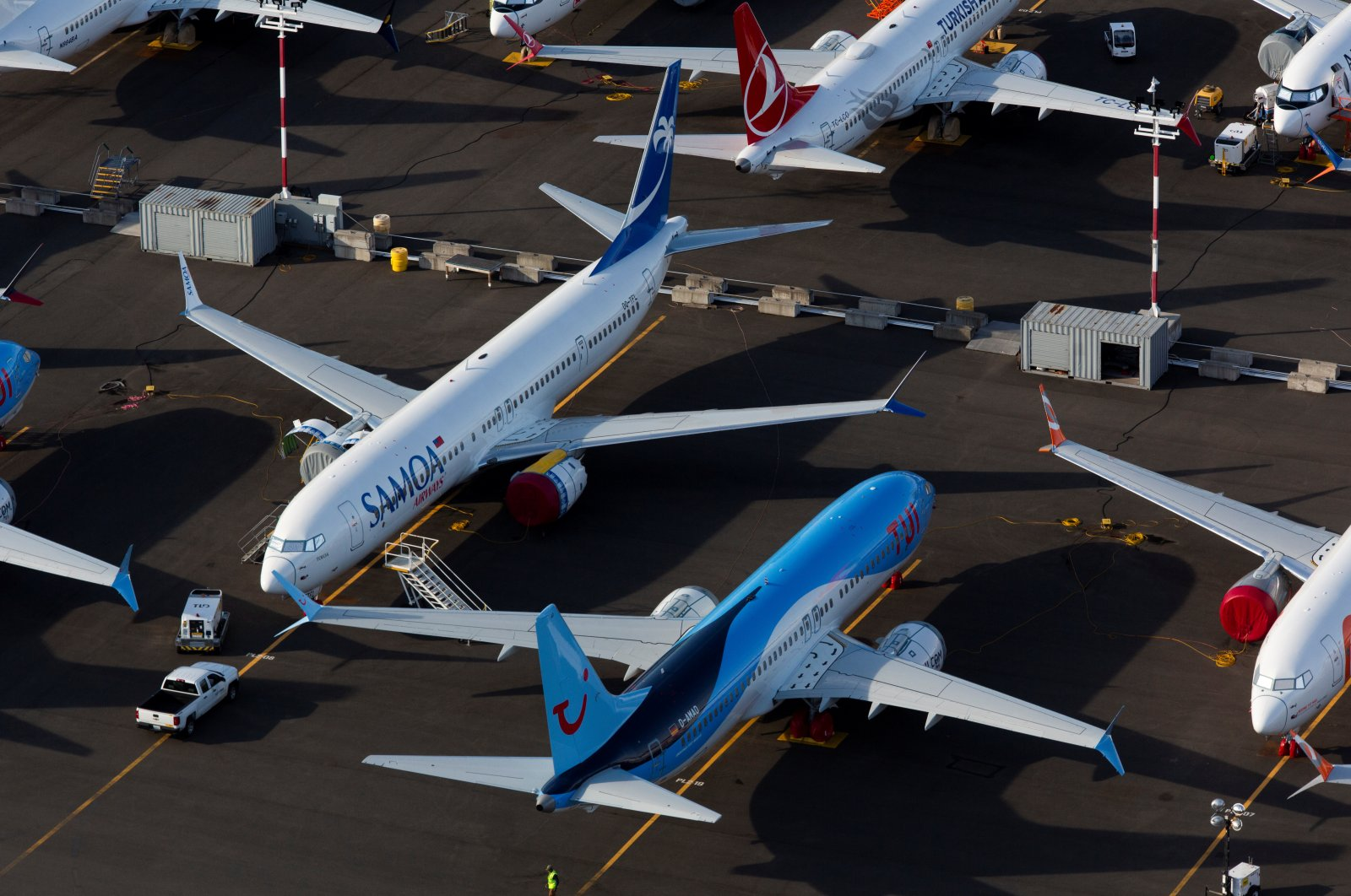 Boeing 737 Max aircraft are parked in a lot at Boeing Field in this aerial photo over Seattle, Washington, June 11, 2020. (Reuters Photo)