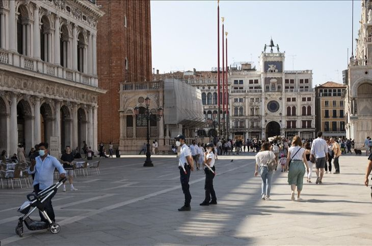 As Italy has eased the lockdown aimed at curbing the spread of the COVID-19 infection, local police officers wearing protective face masks patrol San Marco Square in Venice, Italy, June 13, 2020. ( AA Photo)