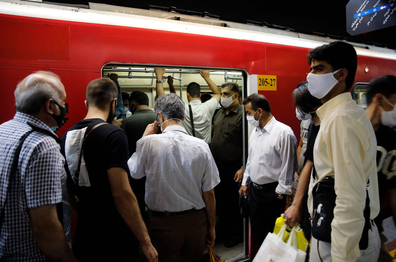 Iranians, mostly wearing face masks, are pictured at a metro station in the capital Tehran on June 10, 2020, amid the COVID-19 pandemic. (AFP Photo)