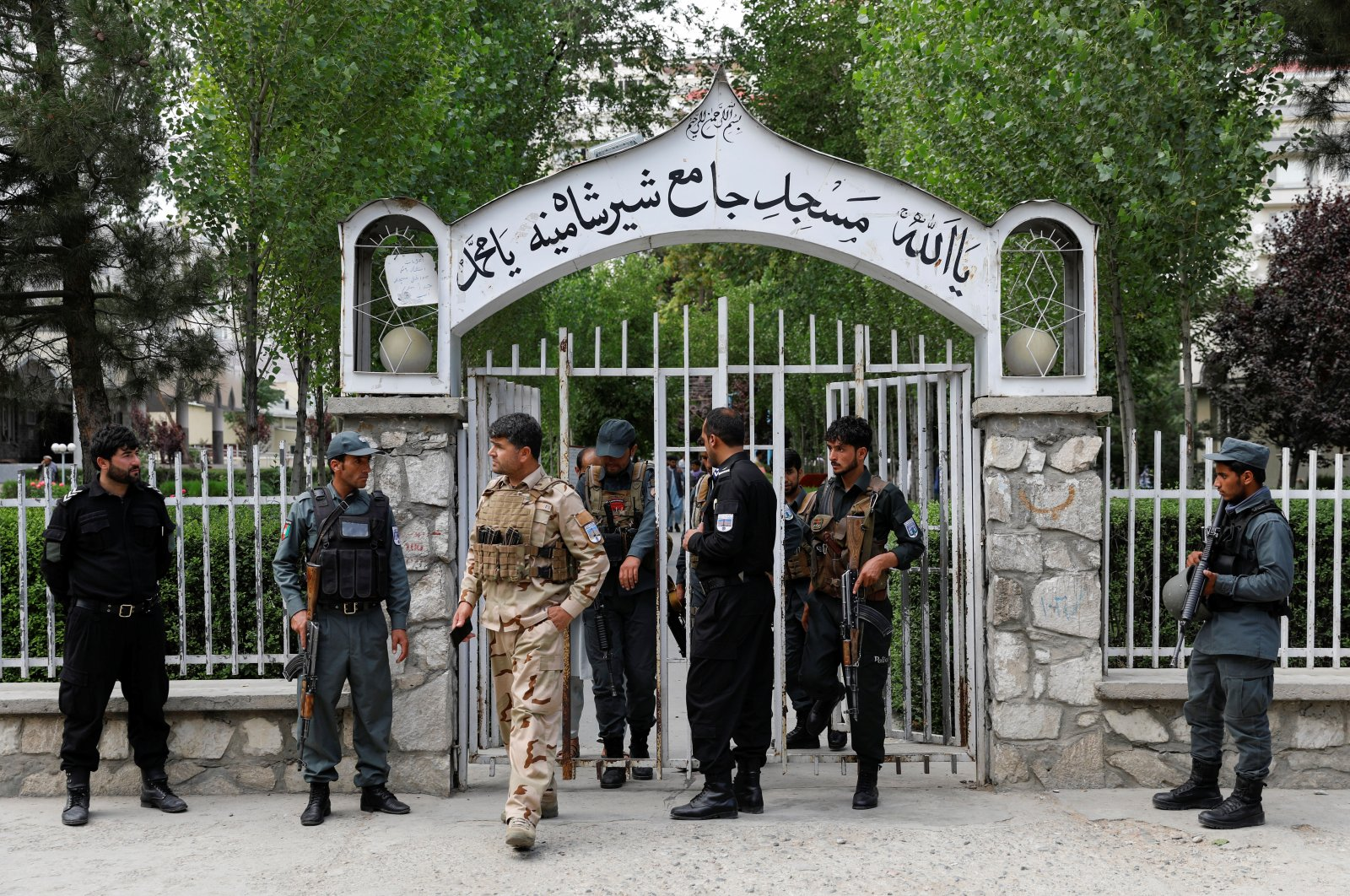 Afghan policemen inspect at the gate of a mosque after a blast in Kabul, Afghanistan, June 12, 2020. (Reuters Photo)