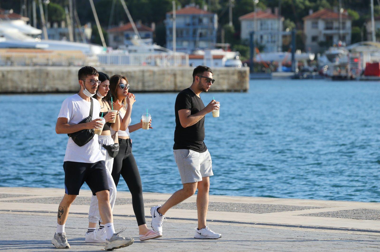 Young people walk along the coast in Izmir, Turkey, June 14, 2020. (AA Photo)