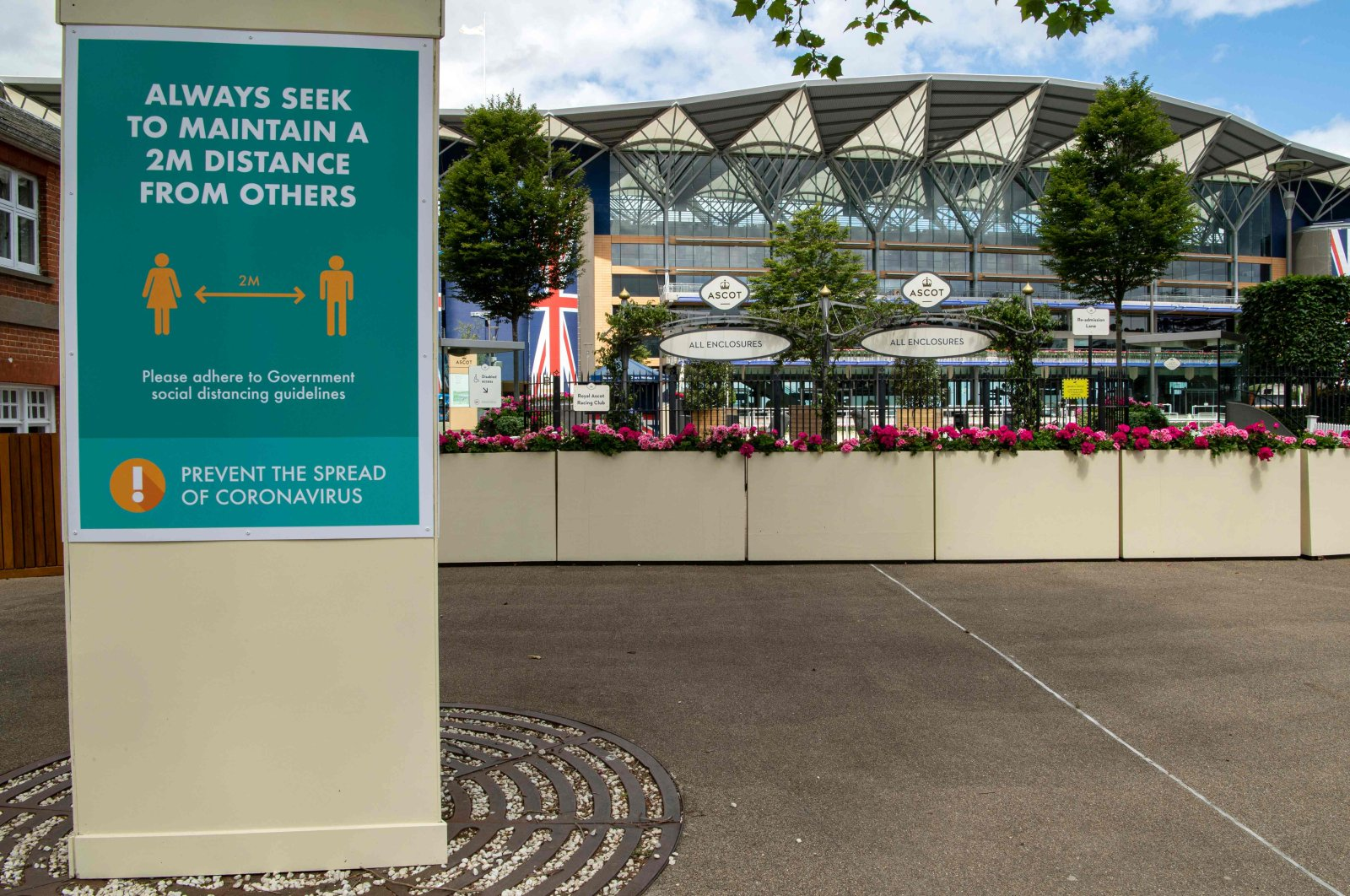 A notice advises people on social distancing rules ahead of Royal Ascot 2020, due to take place behind closed doors at the racecourse, west of London, U.K., June 14, 2020. (AFP Photo)
