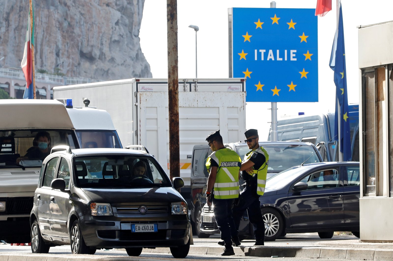 French gendarmes approach a car driver at the border check point Saint-Ludovic at the Franco-Italian border, after France reopened its border to Italians as COVID-19 travel restrictions across Europe are gradually eased, in Menton, France, June 15, 2020. (Reuters Photo)