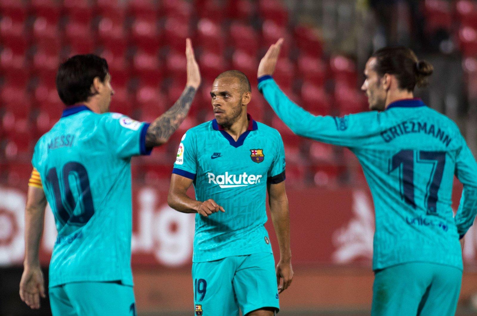 Barcelona's Martin Braithwaite (C) celebrates with Lionel Messi (L) and Antoine Griezmann after scoring a goal against Mallorca, in Palma de Mallorca, Spain, June 13, 2020. (AFP Photo)
