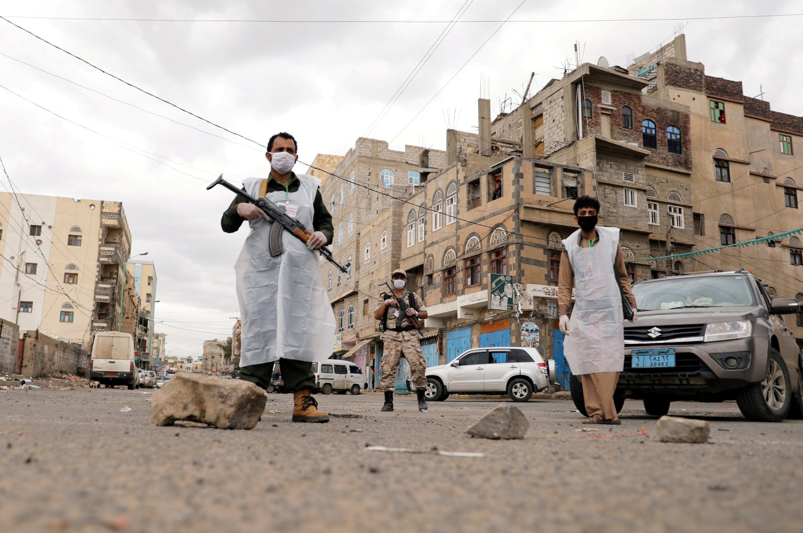 Security men wearing protective masks stand on a street during a 24-hour curfew amid concerns about the spread of the coronavirus, Sanaa, Yemen, May 6, 2020. (Reuters Photo)