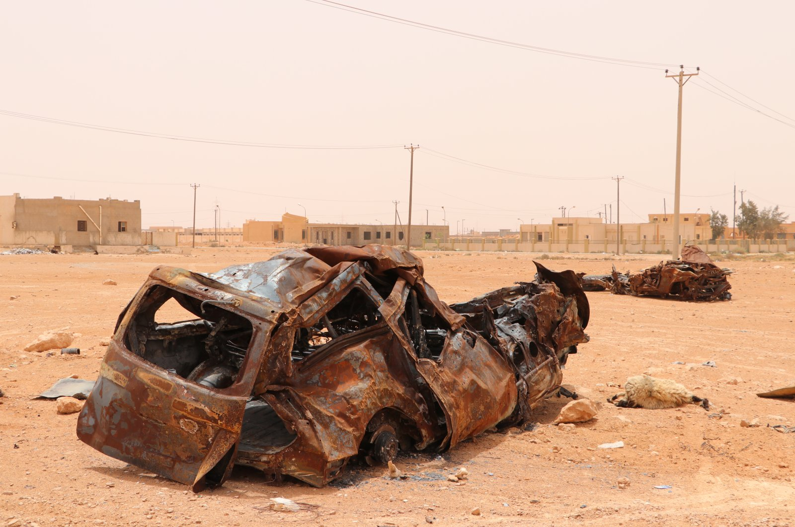 A car turned into scrap due to conflicts in Sirte, Libya, June 15, 2020. (AA)