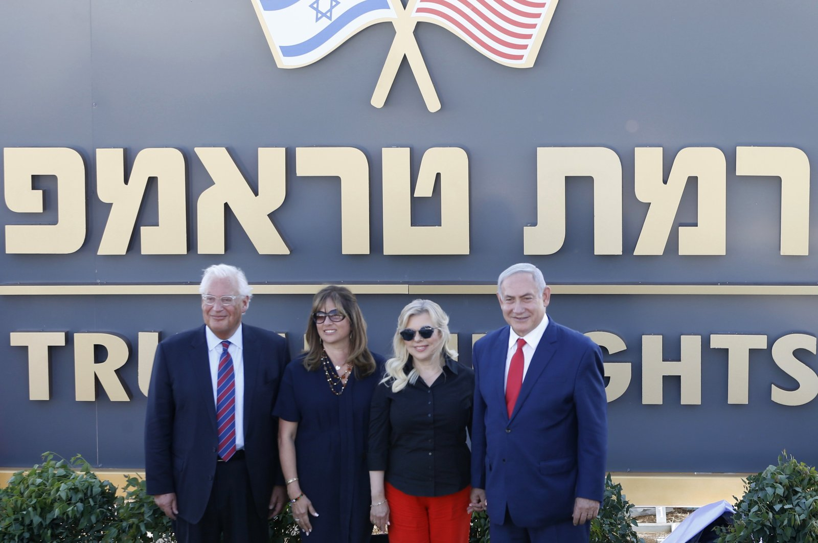 U.St. Ambassador to Israel David Friedman (L) and his wife Tammy Friedman (2nd L) pose with Israeli Prime Minister Benjamin Netanyahu's wife, Sara Netanyahu (2nd R), and Israeli Prime Minister Benjamin Netanyahu during the inauguration of a new settlement named after U.S. President Donald Trump in the Golan Heights, June 16, 2019. (AP Photo)
