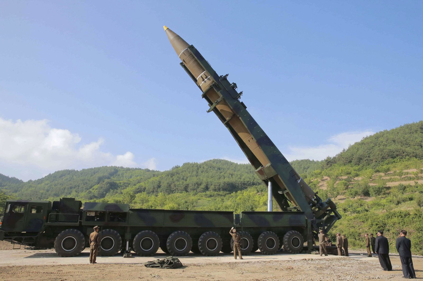 North Korean leader Kim Jong Un, (second from right), inspects the preparation of the launch of a Hwasong-14 intercontinental ballistic missile (ICBM) in North Korea's northwest, July 4, 2017. (AP Photo)