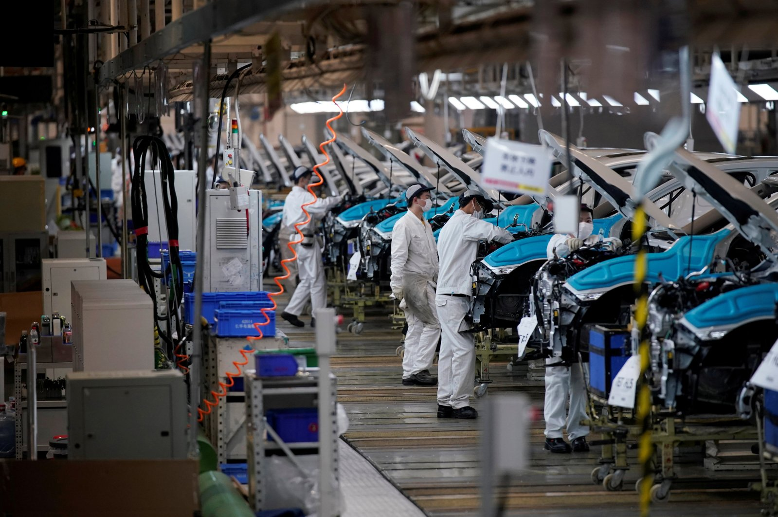 Employees work on a production line inside a Dongfeng Honda factory after lockdown measures in Wuhan, the capital of Hubei province and China's epicenter of the coronavirus outbreak, were further eased, April 8, 2020. (Reuters Photo)