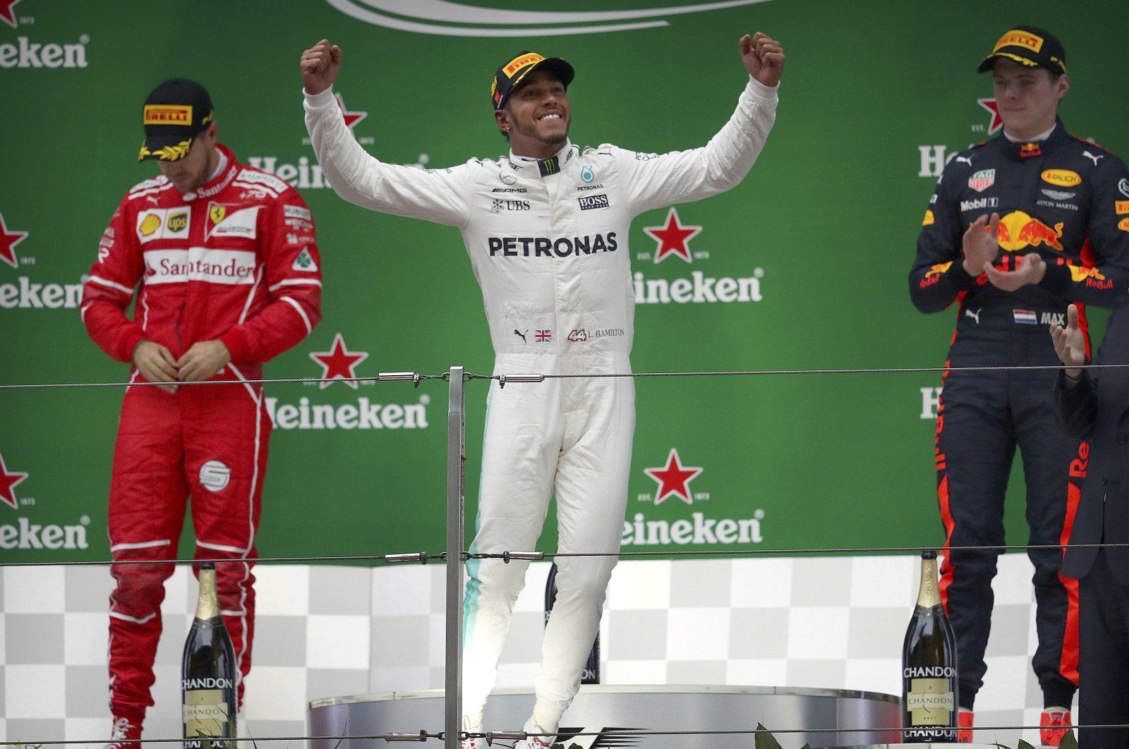 Lewis Hamilton (C), Sebastian Vettel (L) and Max Verstappen at the podium at the Chinese Grand Prix, in Shanghai, China, April 9, 2017. (AP Photo)