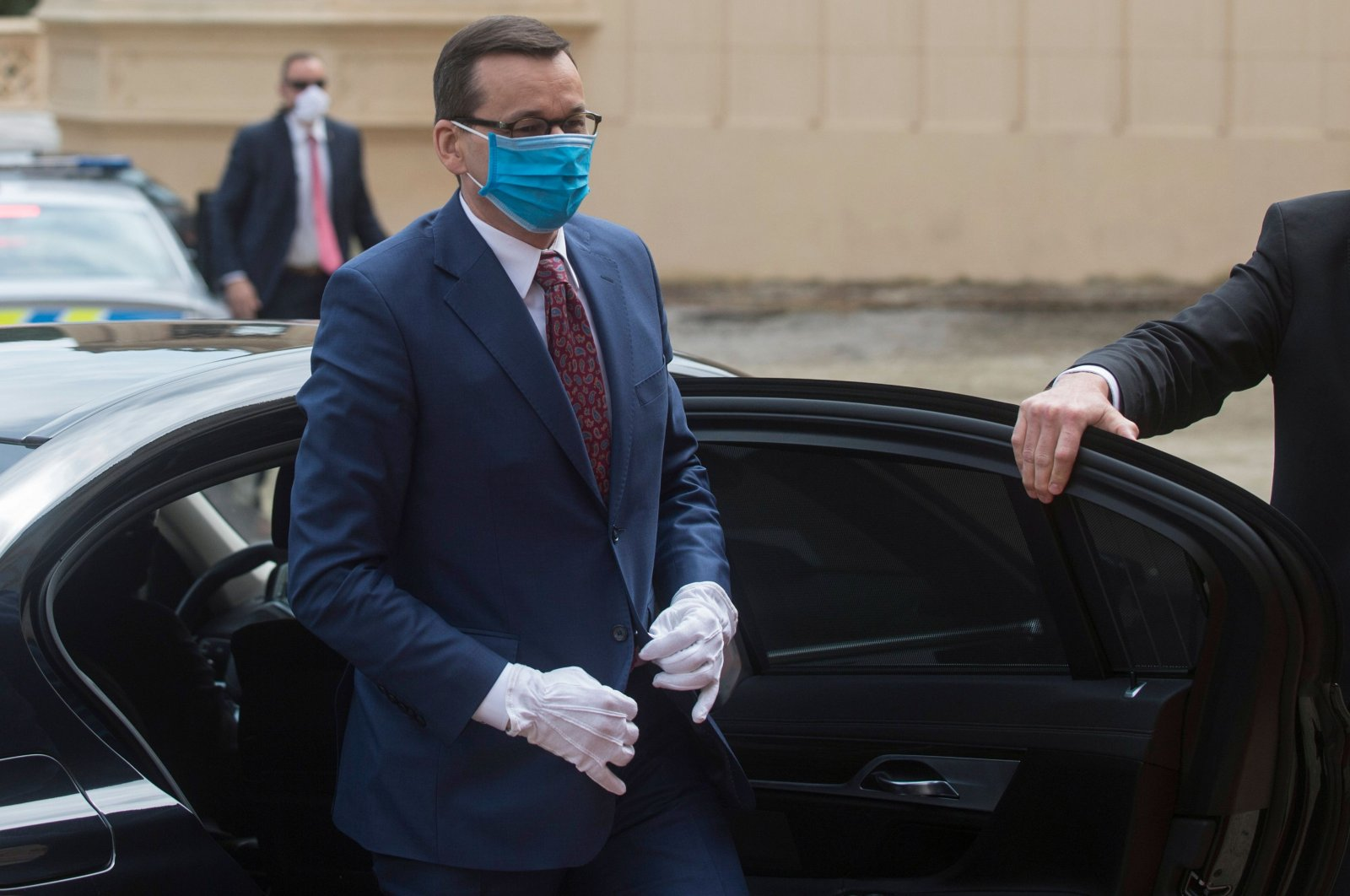 Poland's Prime Minister Mateusz Morawiecki, wearing gloves and a face mask, arrives for the Visegrad Group (V4) meeting on June 11, 2020 in Chateau Lednice, Czech Republic. (AFP Photo)