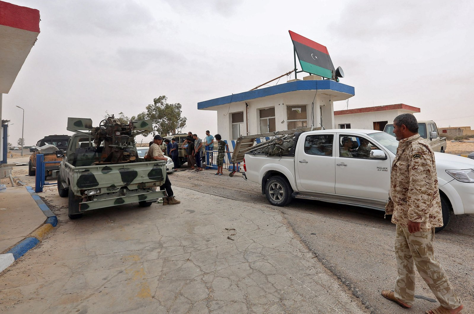 Vehicles of forces loyal to Libya's U.N.-recognized Government of National Accord (GNA) are seen outside a checkpoint at al-Watiya airbase, which they seized control of, southwest of the capital Tripoli, May 18, 2020. (AFP Photo)