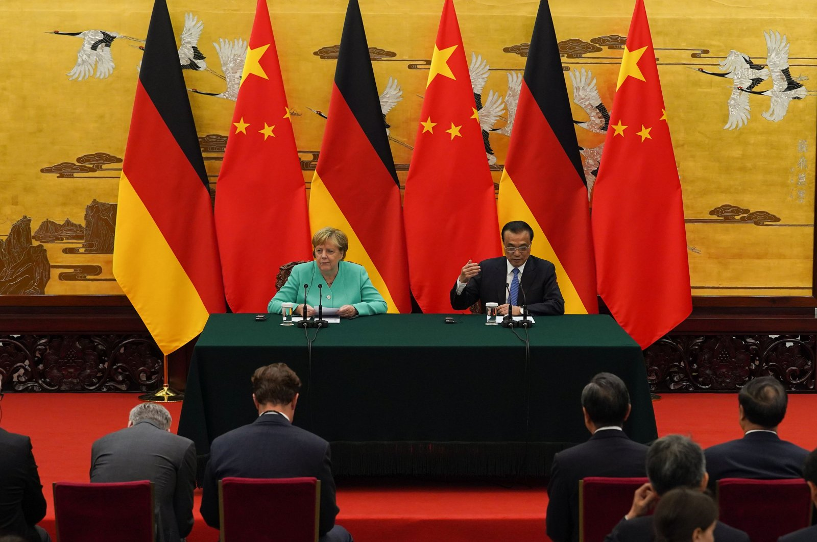 This Sept. 6, 2019, file photo shows Chinese Premier Li Keqiang (R) and German Chancellor Angela Merkel giving a press conference following a meeting at the Great Hall of the People in Beijing. (AFP File Photo)