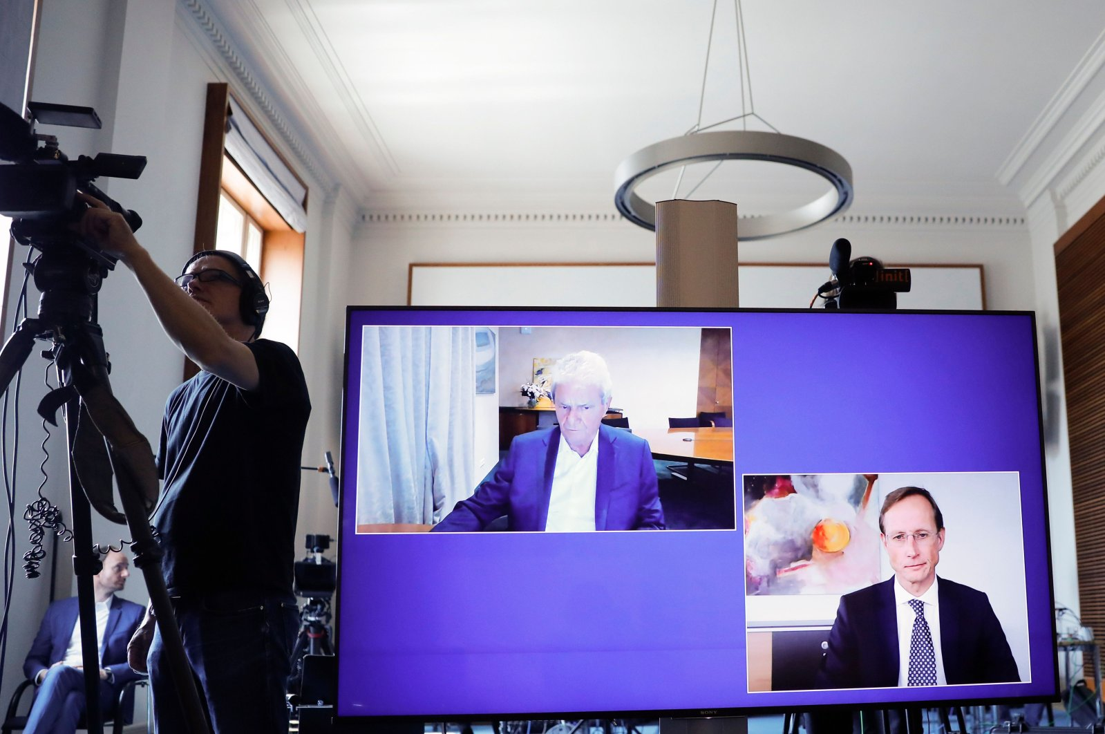 CureVac main shareholder Dietmar Hopp (L) and CureVac CEO Franz-Werner Haas are displayed on a screen during a news conference at the economy ministry in Berlin, Germany, June 15, 2020. (AFP Photo)