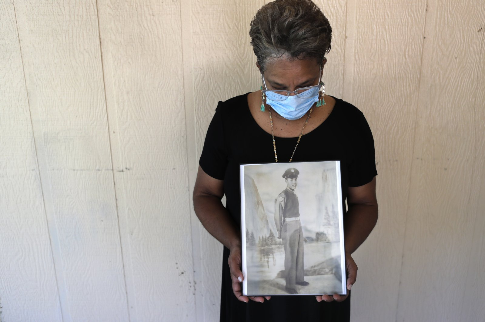 Belvin Jefferson White poses with a portrait of her father, Saymon Jefferson, who died of COVID-19, at Saymon's home in Baton Rouge, Louisana, U.S., May 18, 2020. (AP Photo)