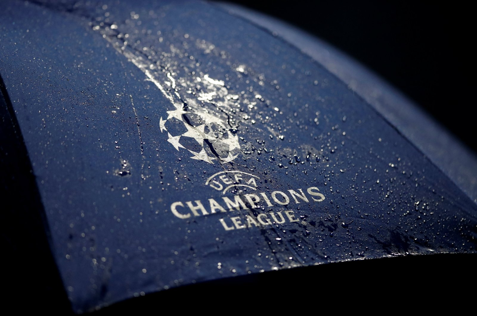 The Champions League logo is seen on an umbrella. (Reuters Photo)