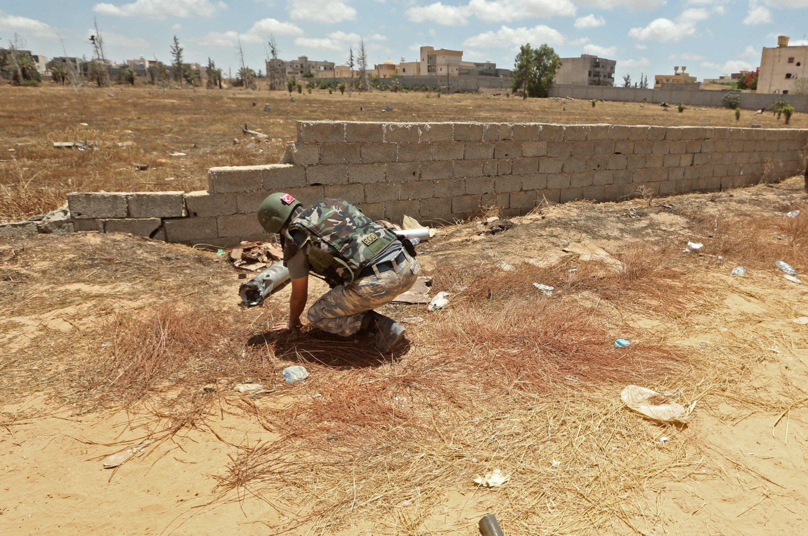 A Turkish de-miner takes part in the clearance of unexploded ordnance in the area of Salah al-Din, south of the Libyan capital Tripoli, June 15, 2020. (AFP Photo)