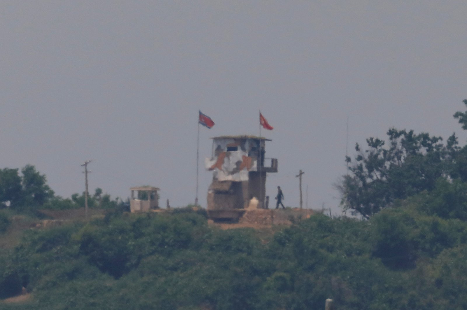 A North Korean soldier is seen beside his guard post inside North Korean territory in this picture taken near the demilitarized zone separating the two Koreas in Paju, South Korea, June 16, 2020. (Reuters Photo)
