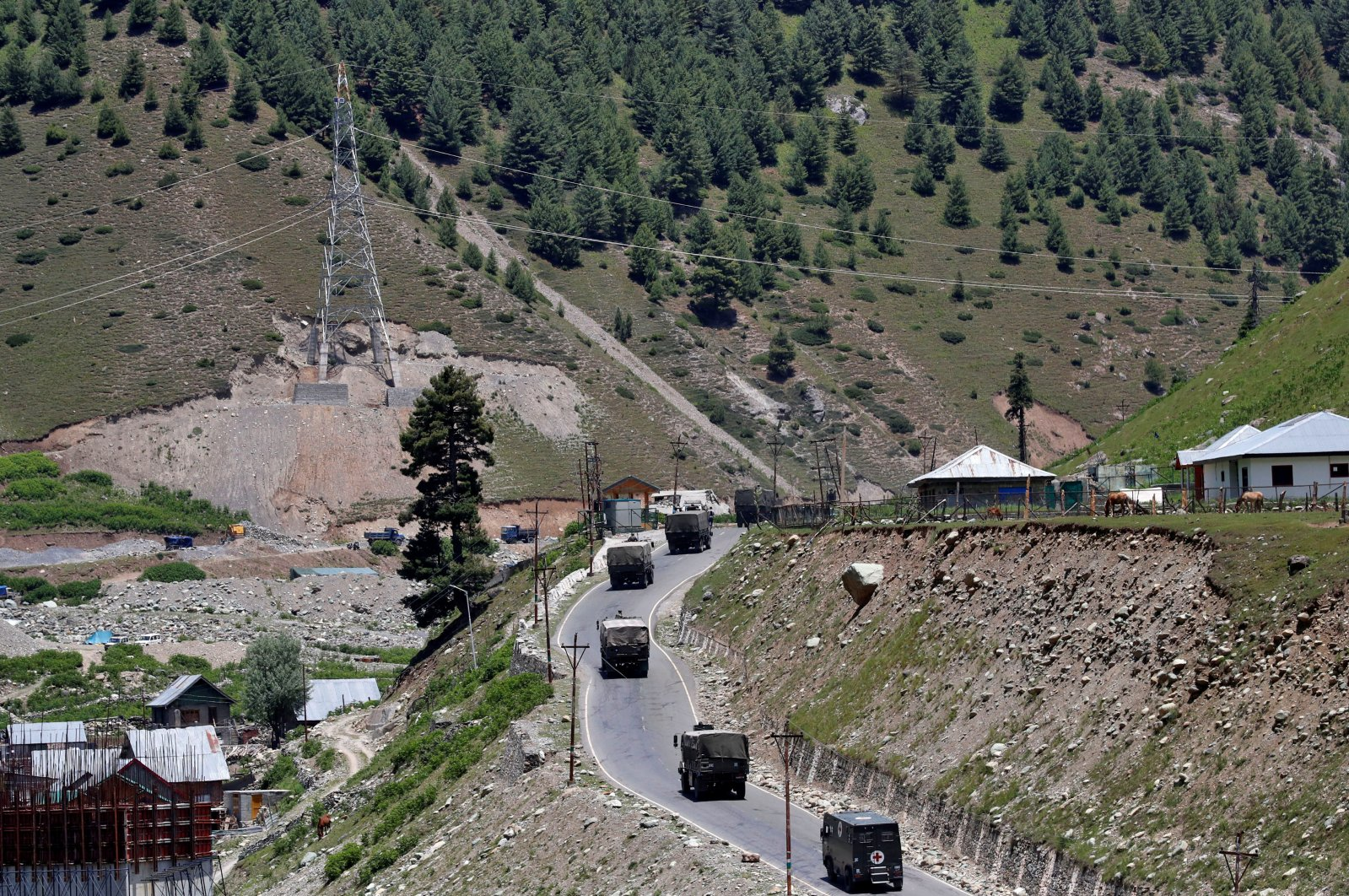 An Indian Army convoy moves along the Srinagar-Leh national highway, at Gagangeer, in east Kashmir's Ganderbal district, June 15, 2020. (Reuters Photo)