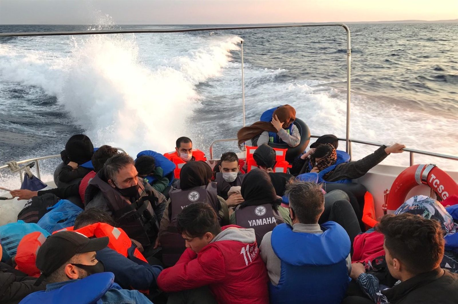Turkish Coast Guard units rescue 125 migrants and refugees in three different operations conducted off the Ayvacık and Bozcaada districts of northwestern Çanakkale province, Turkey, June 15, 2020. (AA Photo)