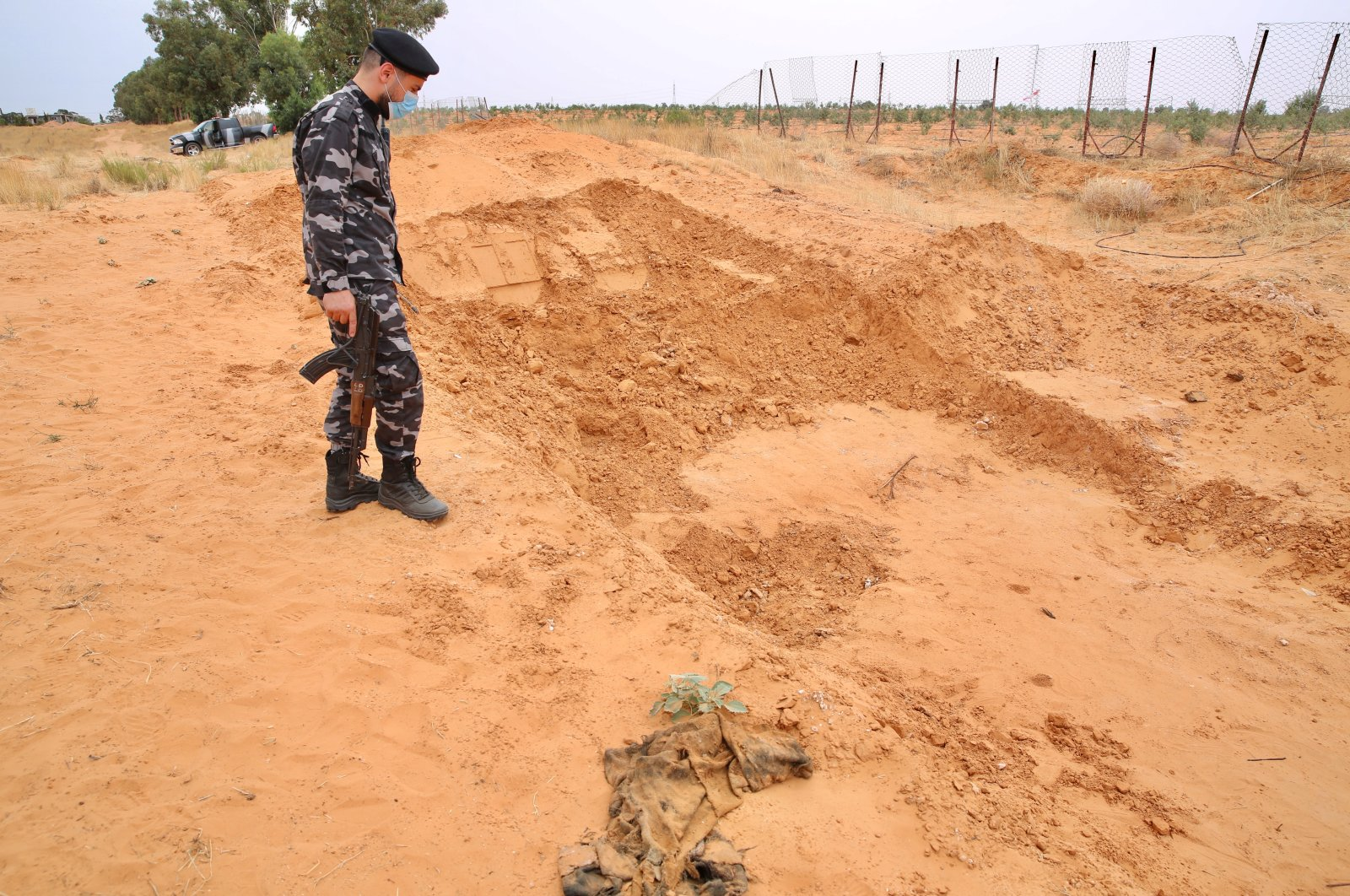 Libyan security forces inspect the site where mass graves were found in the city of Tarhuna, liberated from Khalifa Haftar's militias, Libya, June 12, 2020. (AA Photo)