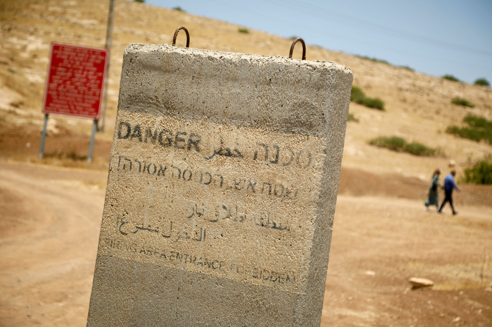 A concrete barrier with writings warning against entering into a firing area is seen in the Jordan Valley in the Israeli-occupied West Bank, Palestine, June 13, 2020. (Reuters Photo)