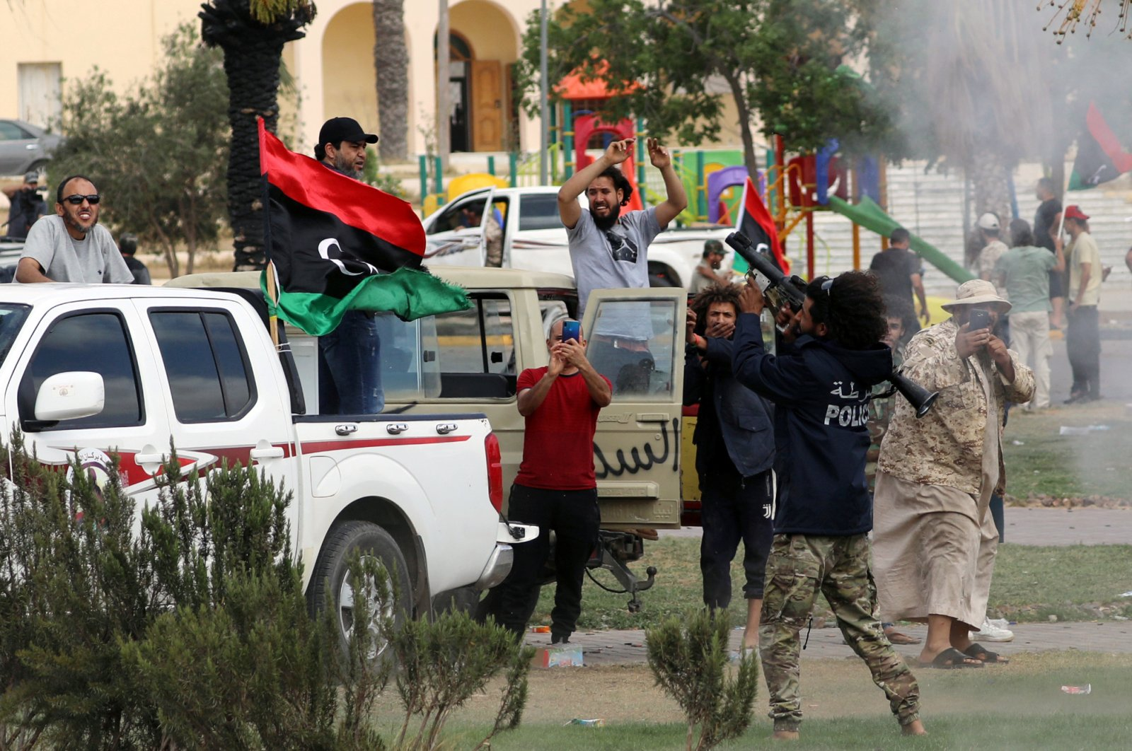 Fighters loyal to Libya's internationally recognized government celebrate after regaining control over Tarhuna city from putschist Gen. Khalifa Haftar forces, Libya, June 5, 2020. (Reuters Photo)