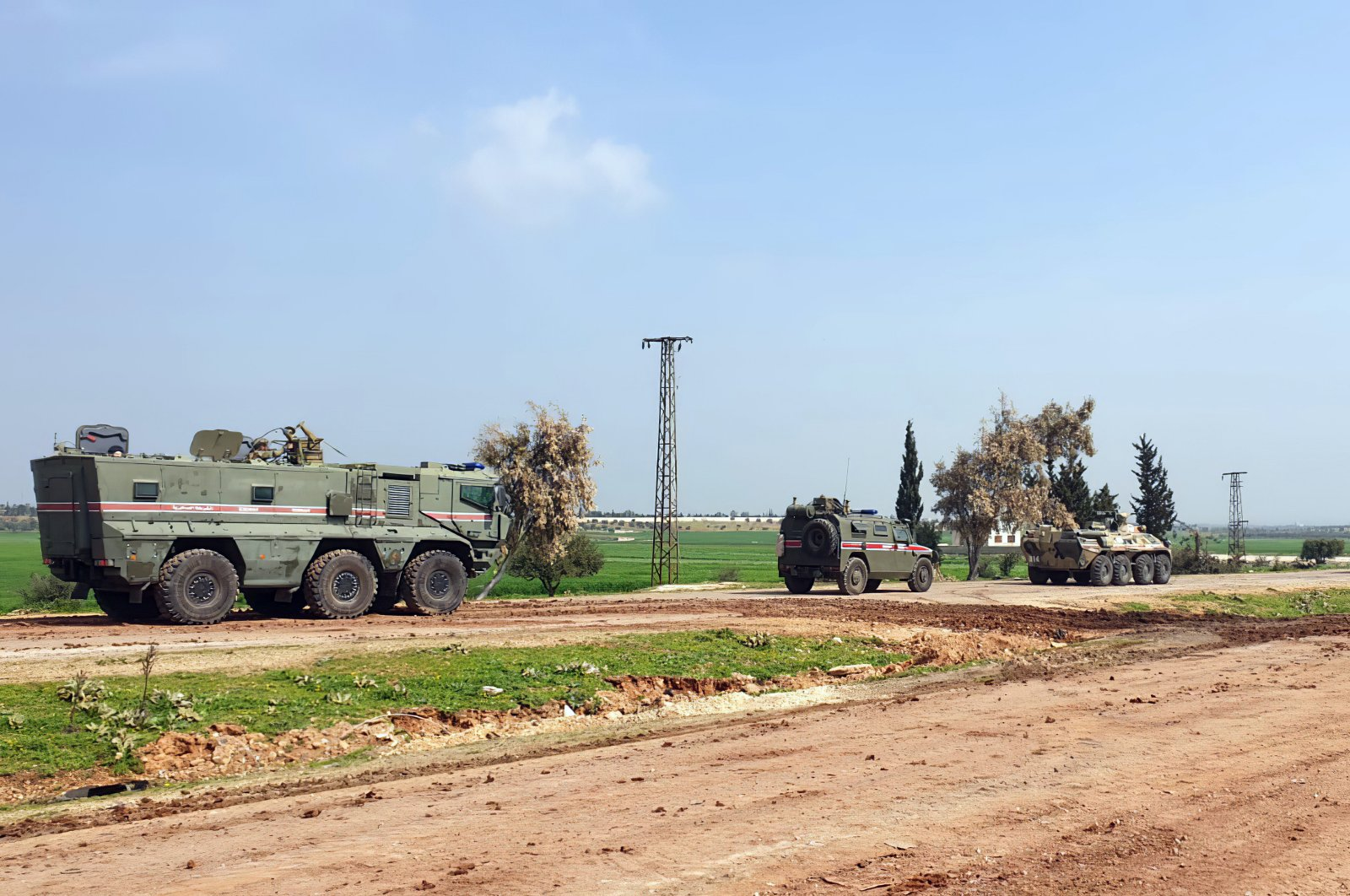 In this photo provided by the Turkish Defense Ministry, Turkish and Russian troops patrol along the M4 highway, which runs east-west through Idlib province, Syria, March 15, 2020. (AP Photo)