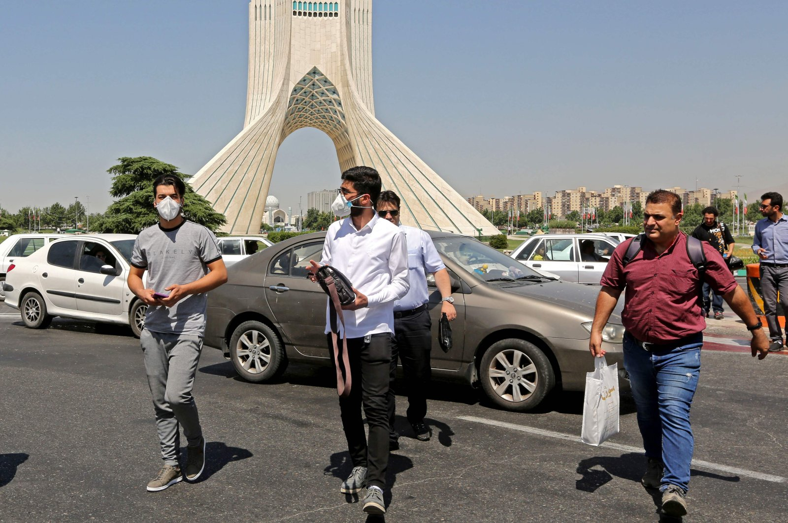 Iranians, mostly wearing face masks, are pictured at Azadi square in the capital Tehran, on June 16, 2020, amid the coronavirus pandemic. (AFP Photo)