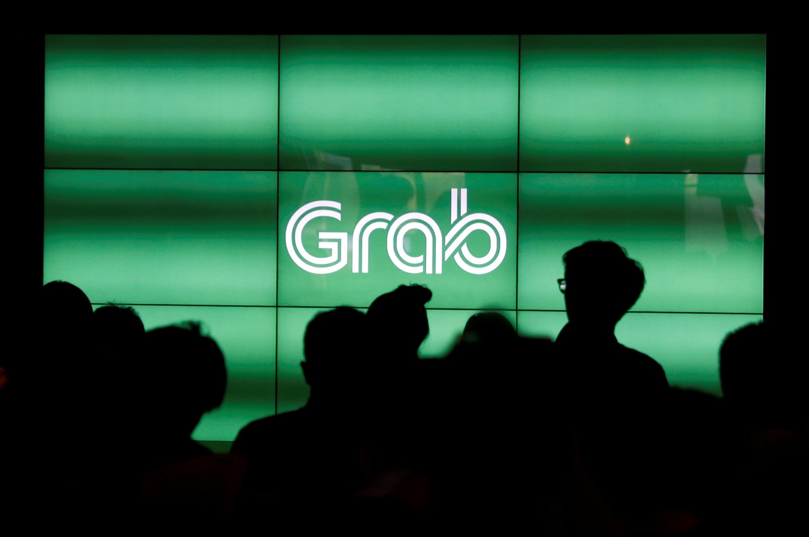 People wait for the start of Grab's fifth anniversary news conference in Singapore June 6, 2017. (Reuters Photo)