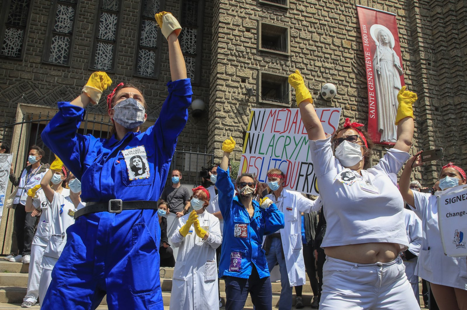 Medical personnel from the Robert Debre hospital, wearing masks to help curb the spread of the coronavirus, stage a protest in Paris, France, June 11, 2020. (AP Photo)