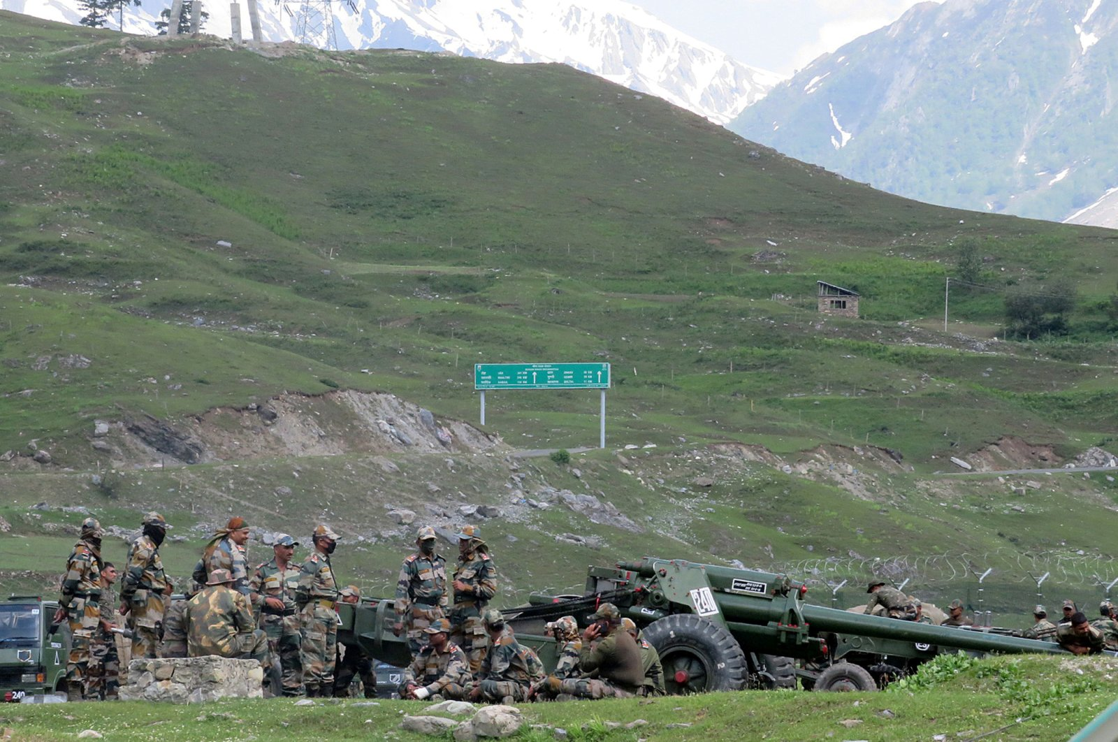 Indian army soldiers rest next to artillery guns at a makeshift transit camp before heading to Ladakh, near Baltal, southeast of Srinagar, June 16, 2020. (Reuters Photo)