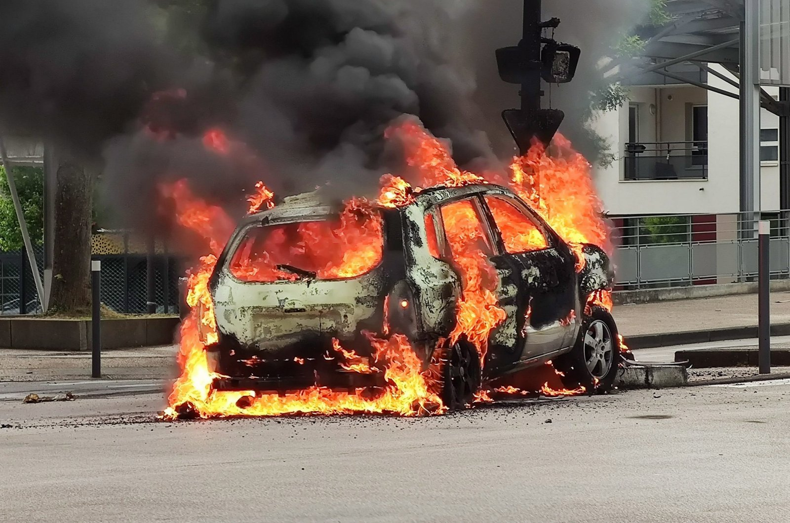 A car burns after scenes of violence in the Gresilles neighborhood in Dijon, France, June 15, 2020. (EPA Photo)