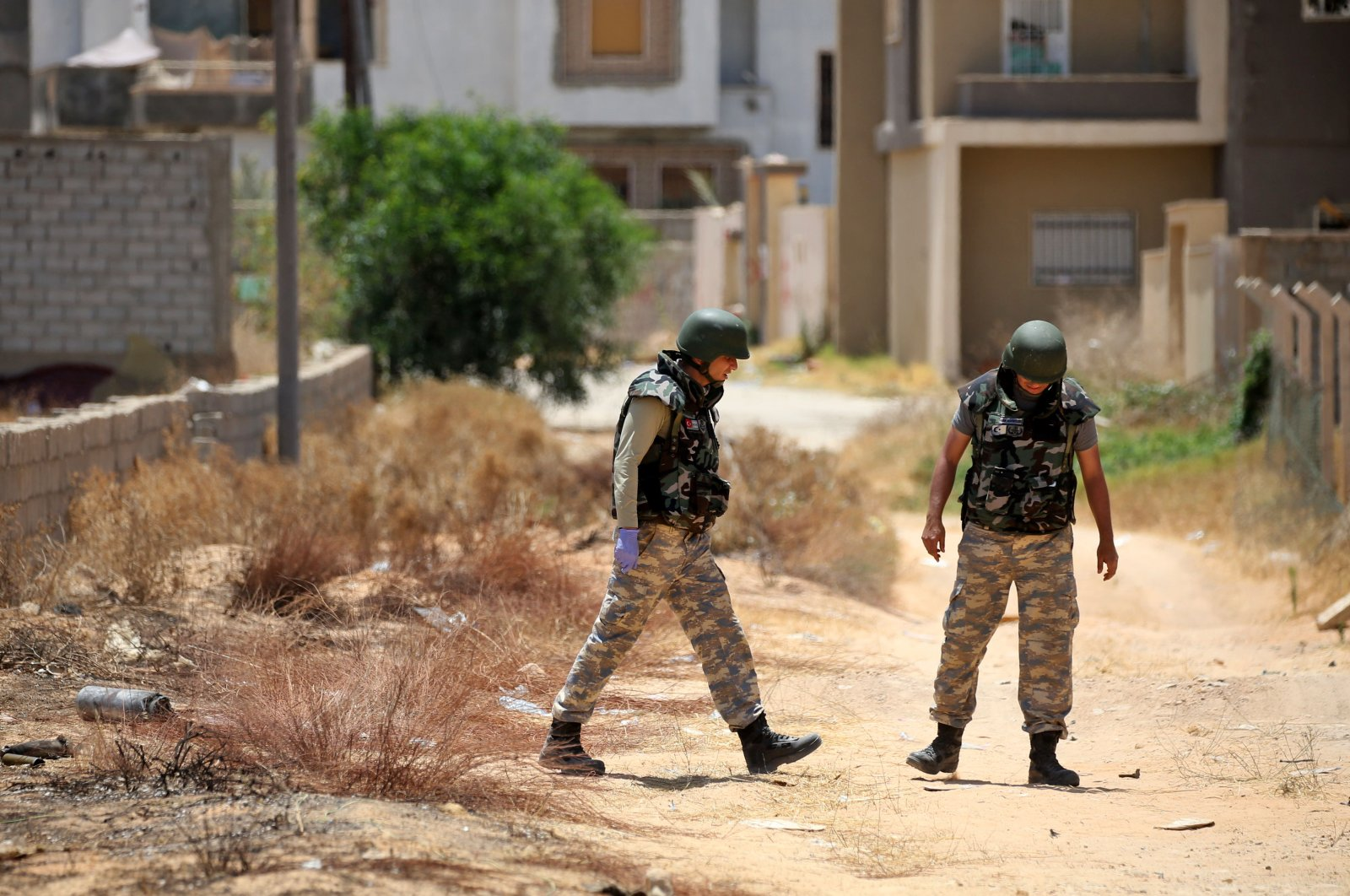 Turkish de-miners search and clear landmines in the area of Salah al-Din, south of the Libyan capital Tripoli, June 15, 2020. (AFP Photo)