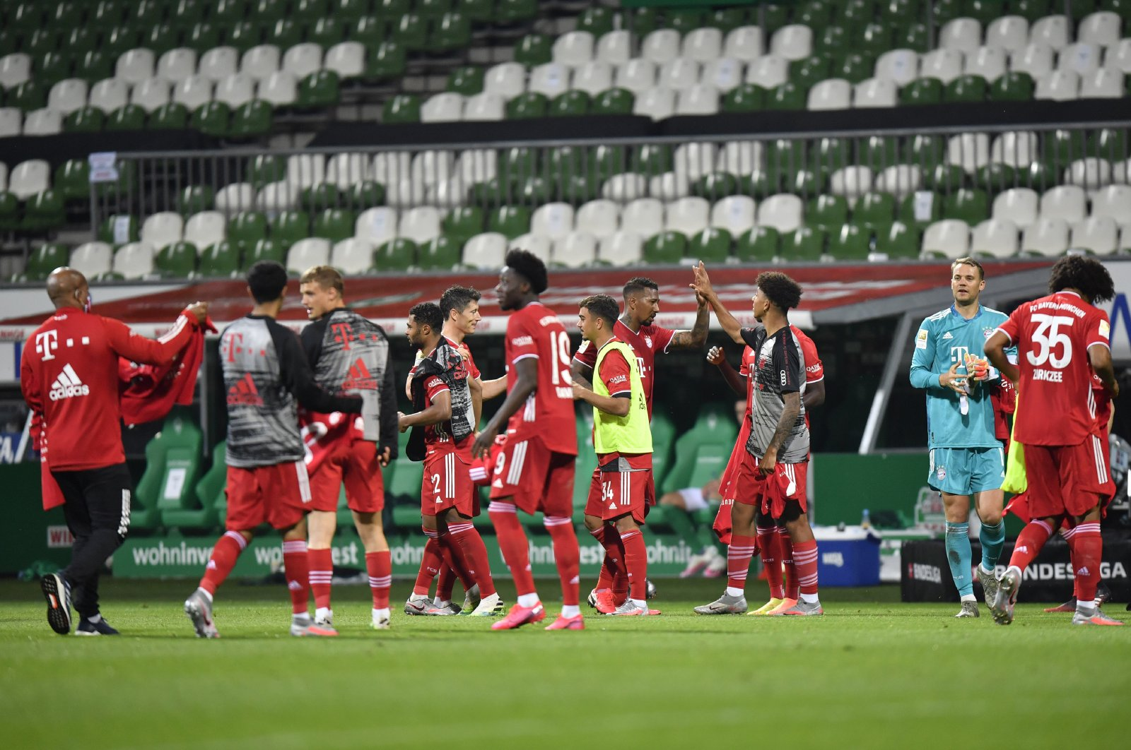 Bayern Munich's players celebrate end of the German Bundesliga football match between Werder Bremen and Bayern Munich in Bremen, Germany, Tuesday, June 16, 2020. (AP Photo)