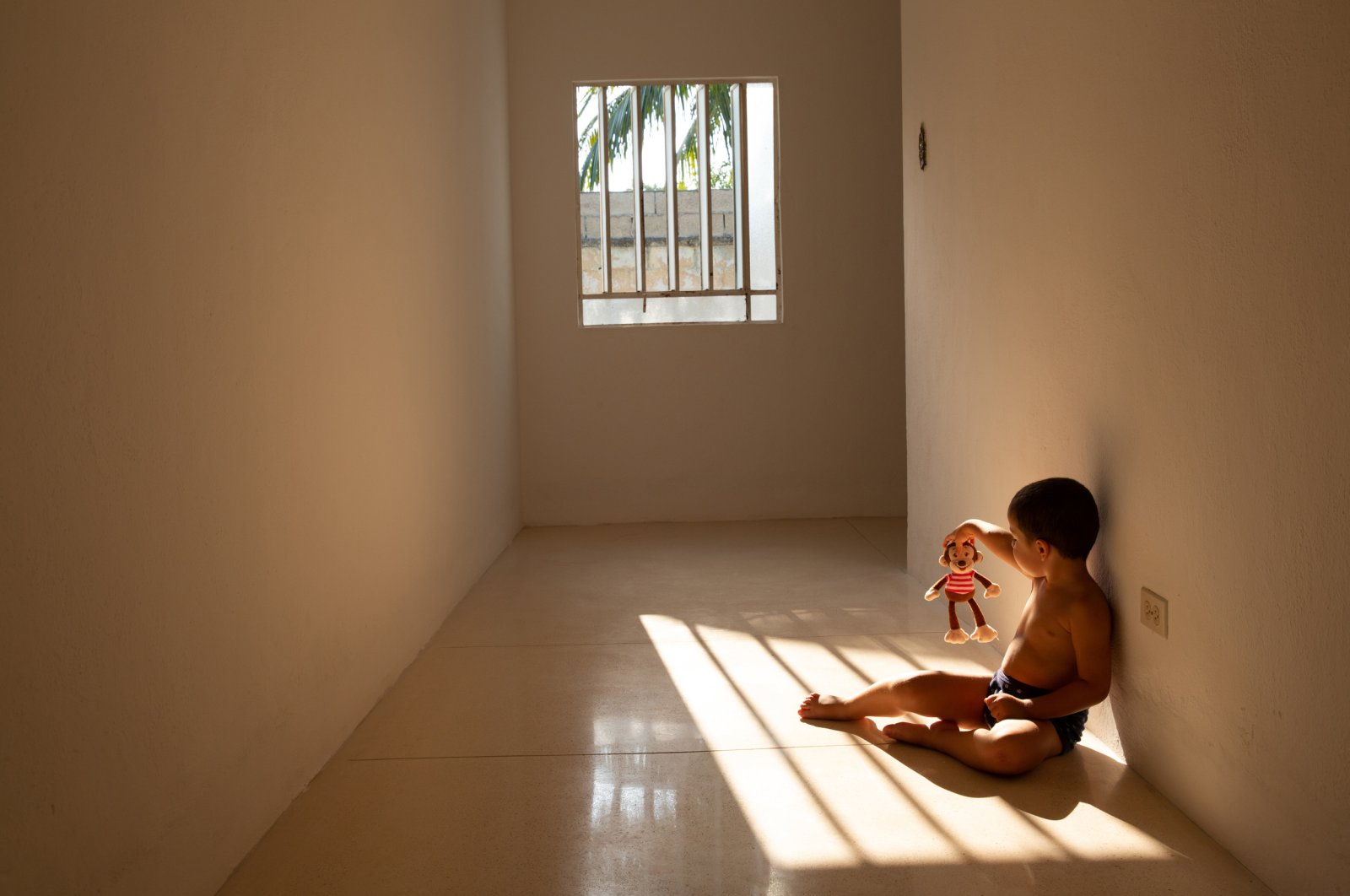 Thiago playing in the sunlight with his toy monkey on his 28th day of self-isolation during the COVID-19 pandemic at a temporary home in Merida, Yucatan, Mexico on April 11, 2020. (Sipa USA Photo via Reuters)
