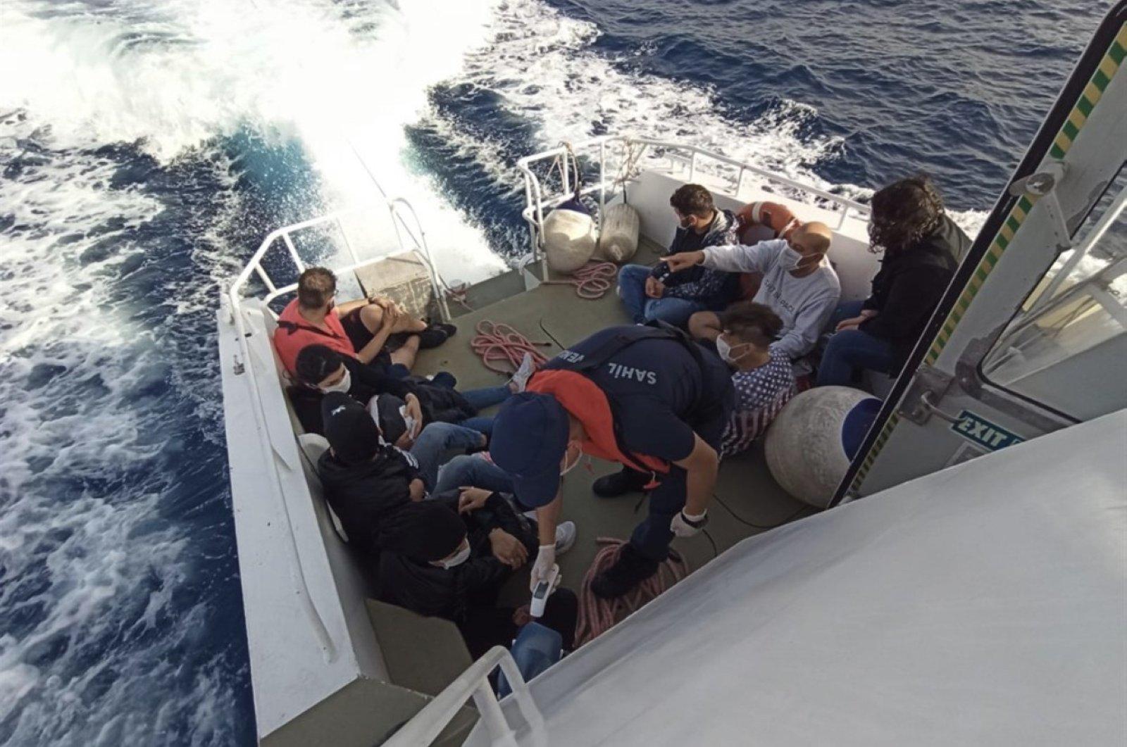The Turkish Coast Guard rescue 10 asylum-seekers from a boat off the coast of Bodrum, Muğla province, Turkey, June 17, 2020. (İHA Photo)
