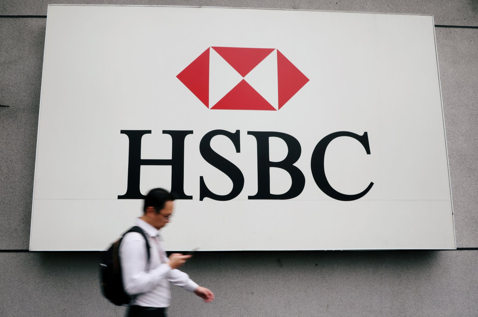 A man walks past a logo of HSBC at its headquarters in Kuala Lumpur, Malaysia, Aug. 6, 2019. (Reuters Photo)