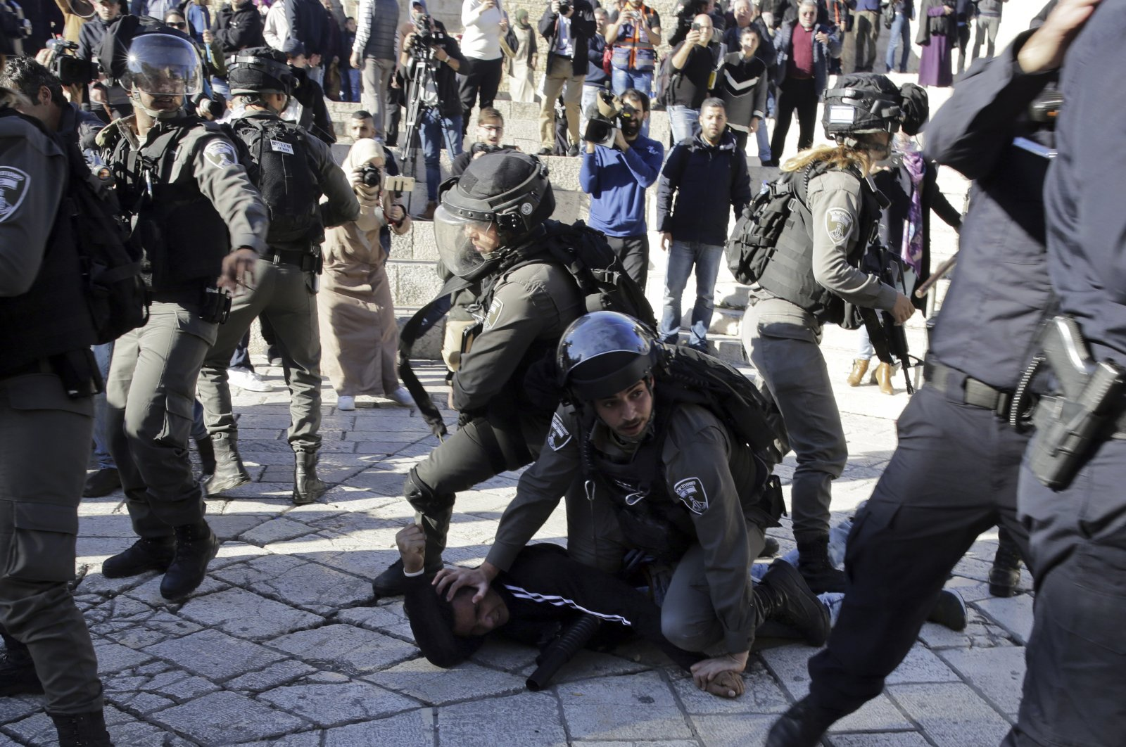 Israeli police officers detain a Palestinian during a protest in Jerusalem, Dec. 8,2017. (AP Photo)