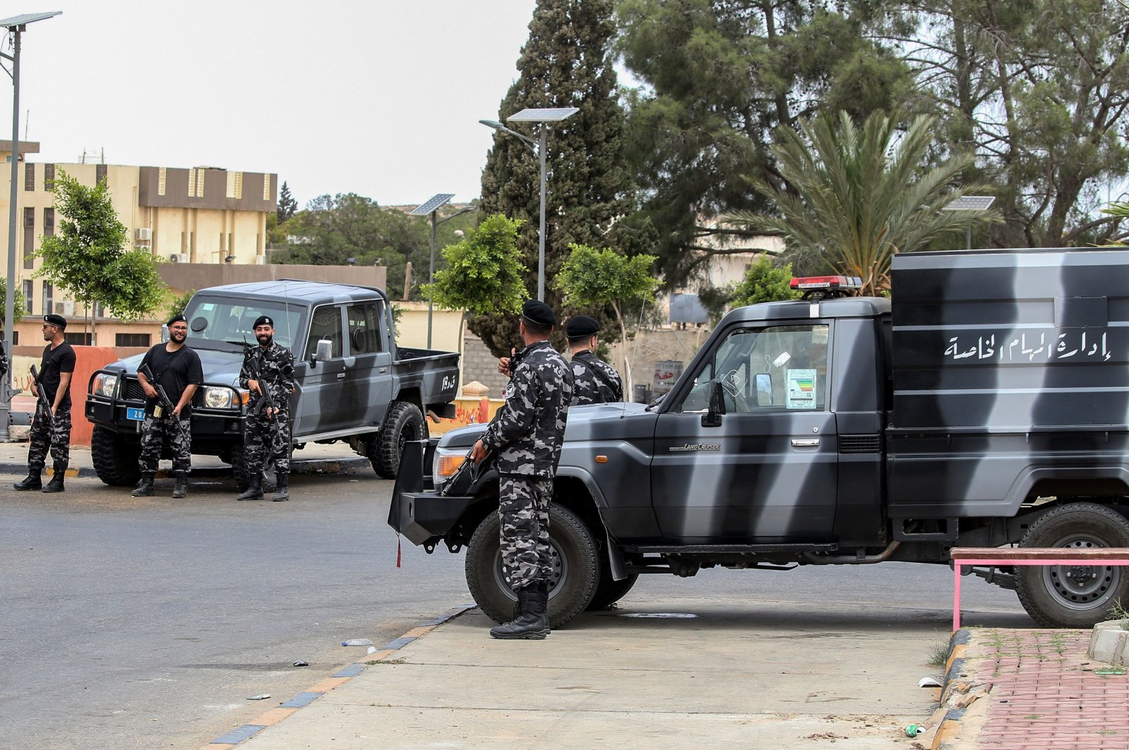 Members of security forces affiliated with the Libyan Government of National Accord (GNA)'s Interior Ministry stand at a makeshift checkpoint in the town of Tarhuna, about 65 kilometers southeast of the capital Tripoli, June 11, 2020. (AFP Photo)