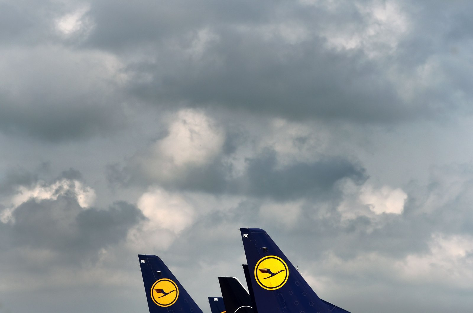 "The tails of aircraft of the German airline Lufthansa are seen at the ""Franz-Josef-Strauss"" airport in Munich, southern Germany, on June 11, 2020. (AFP Photo)"