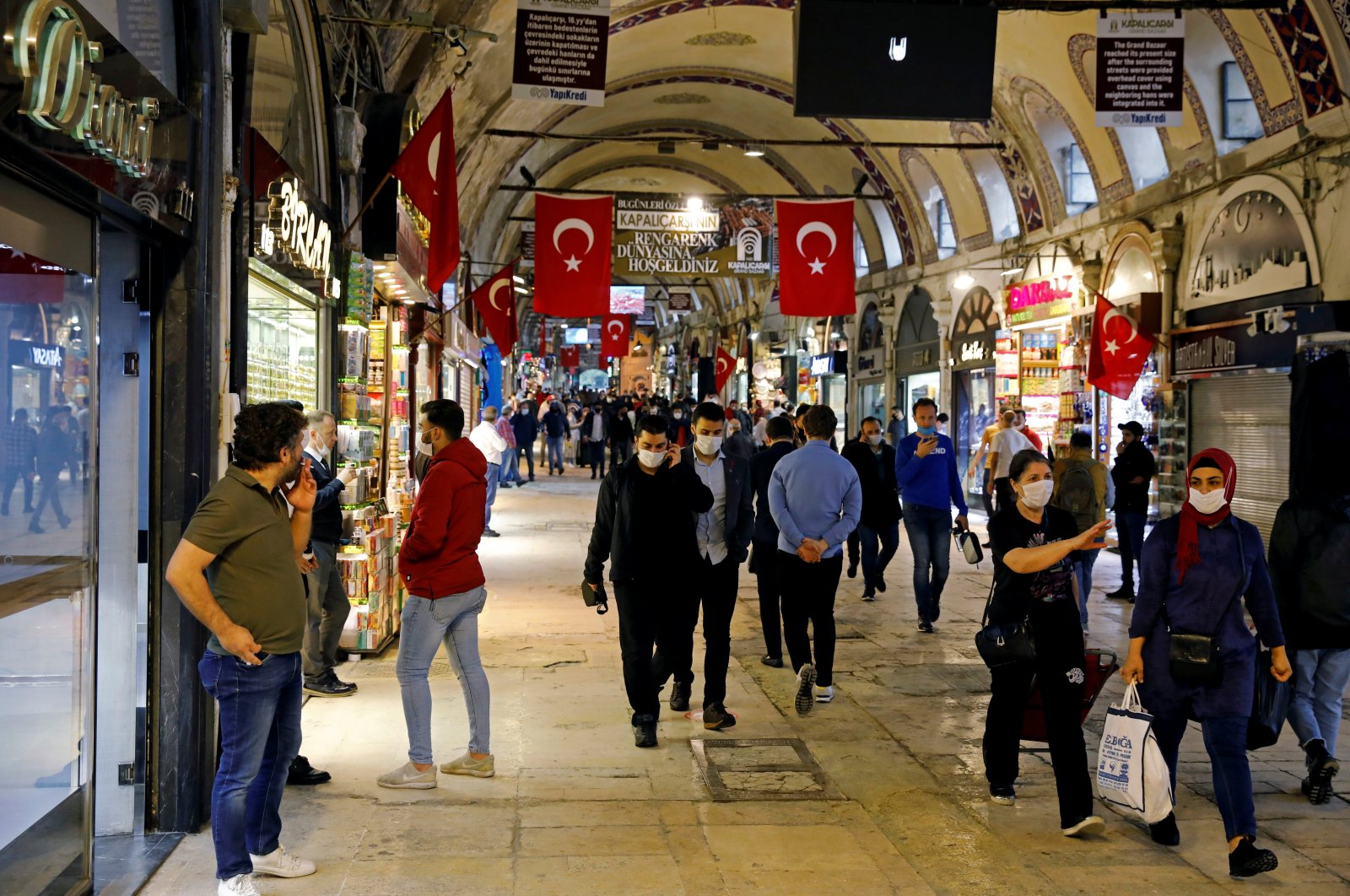 People wearing protective face masks walk at the Grand Bazaar as it reopens after weeks of closed doors amid the spread of the coronavirus in Istanbul, Turkey, June 1, 2020. (Reuters Photo)