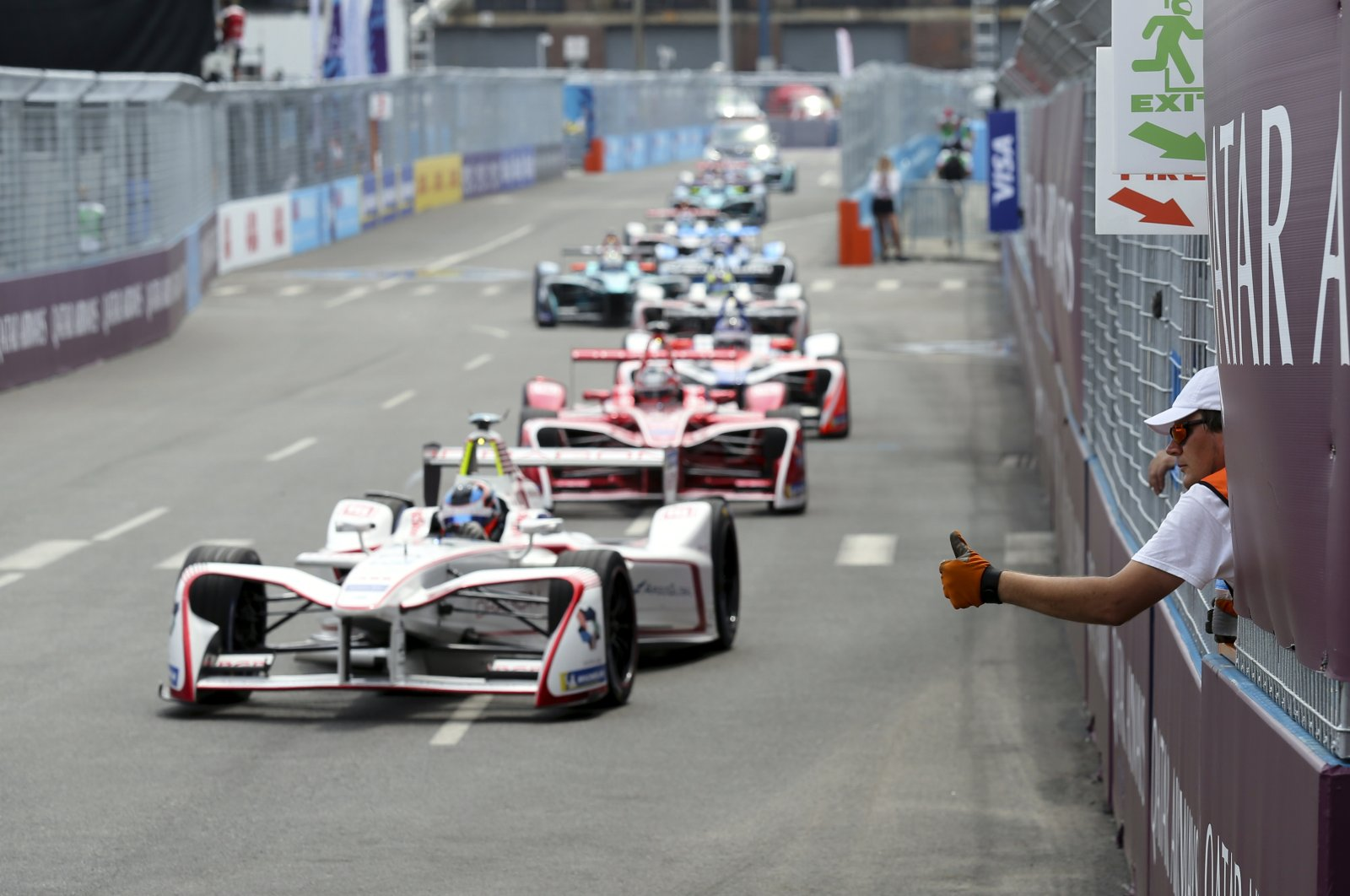 Formula E safety worker gives a thumbs-up to drivers during the second of two auto races in the Formula E championship, in New York City, New York, U.S., July 15, 2018. (AP Photo)